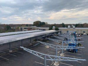 Solar carport steel erection photo during canopy construction.